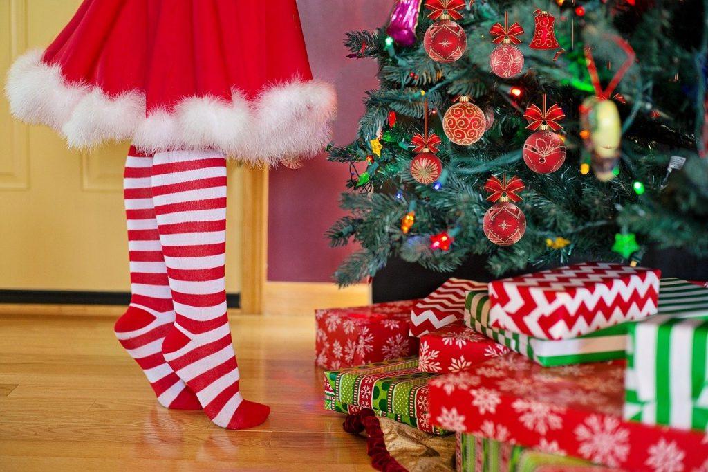 a kid decorating christmas tree